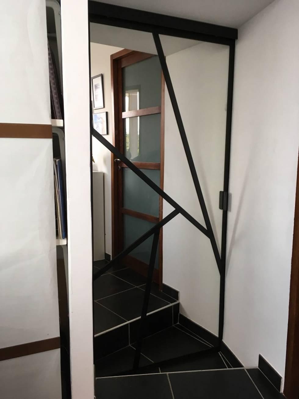 Fabrication et pose de porte suspendue en acier for Fabricant de porte et fenetre